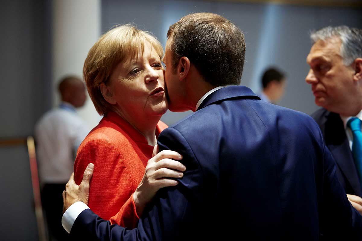 Macron kisses Merkel
