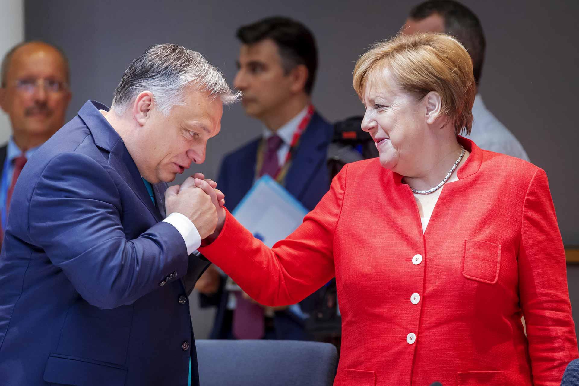 Viktor Orban with Angela Merkel