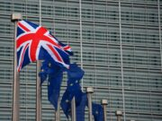 British and European flags in front of the Berlaymont building
