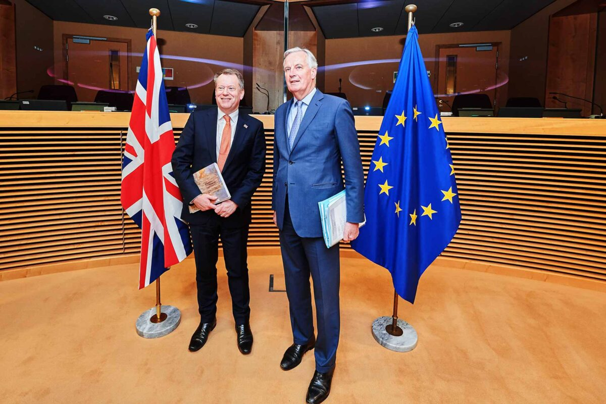 David Frost, on the left, and Michel Barnier