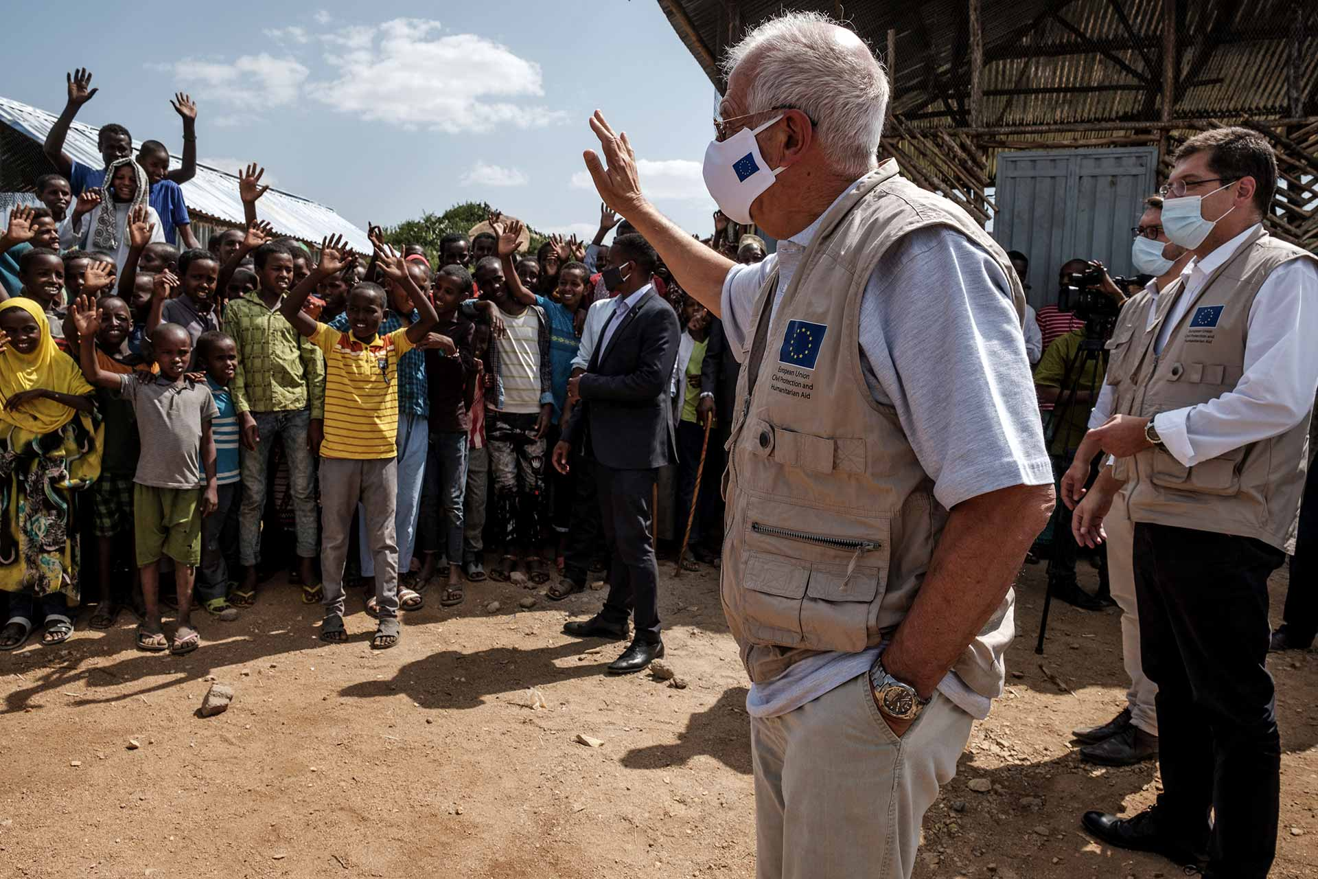 Africa: Josep Borrel, in the center, and Janez Lenarčič, on the right, greet the communities during a visit to the Qoloji Camp for Internally Displaced People, Ethiopia