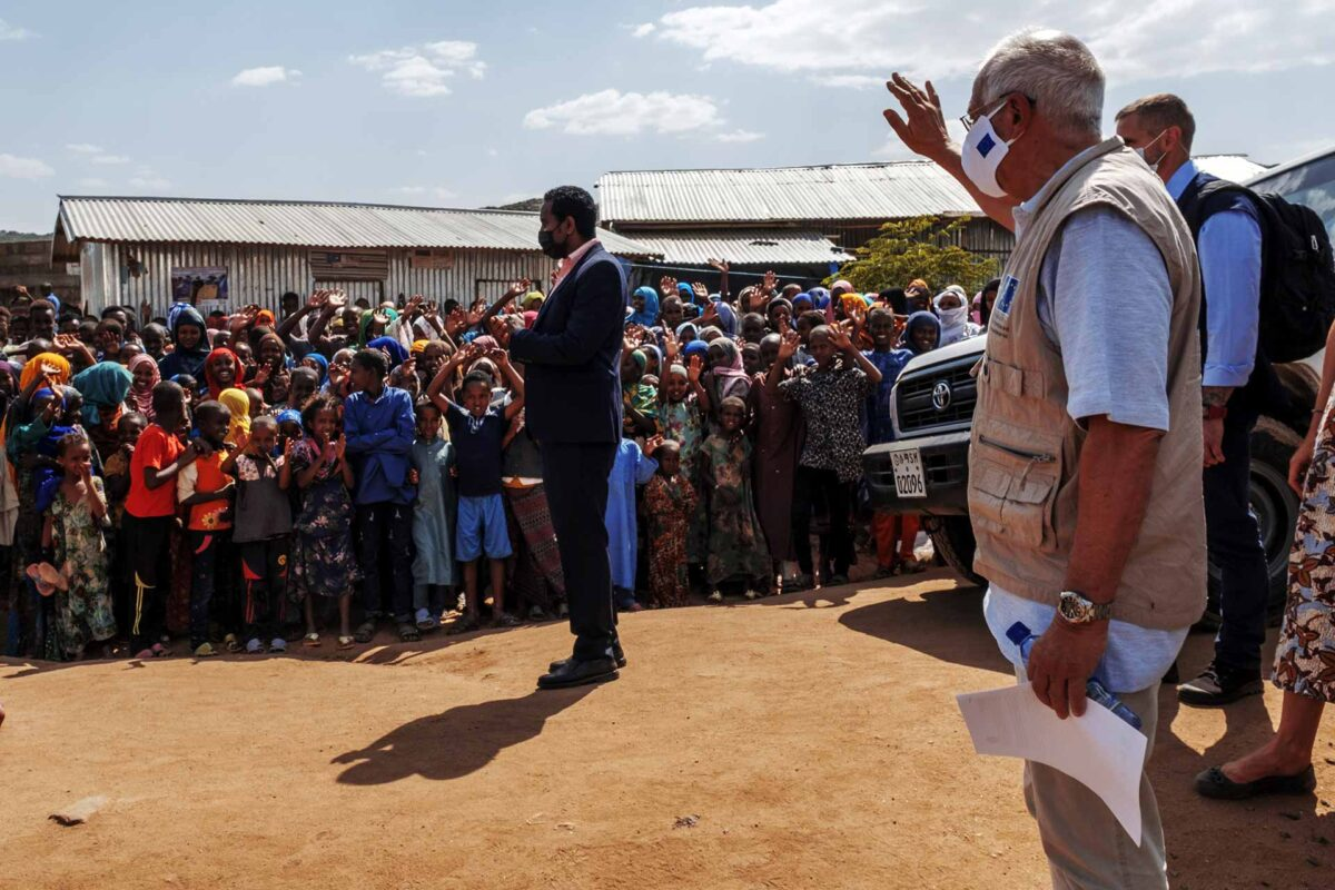 Josep Borrel, second right, greets the communities during a visit to the Qoloji Camp for Internally Displaced People, Ethiopia