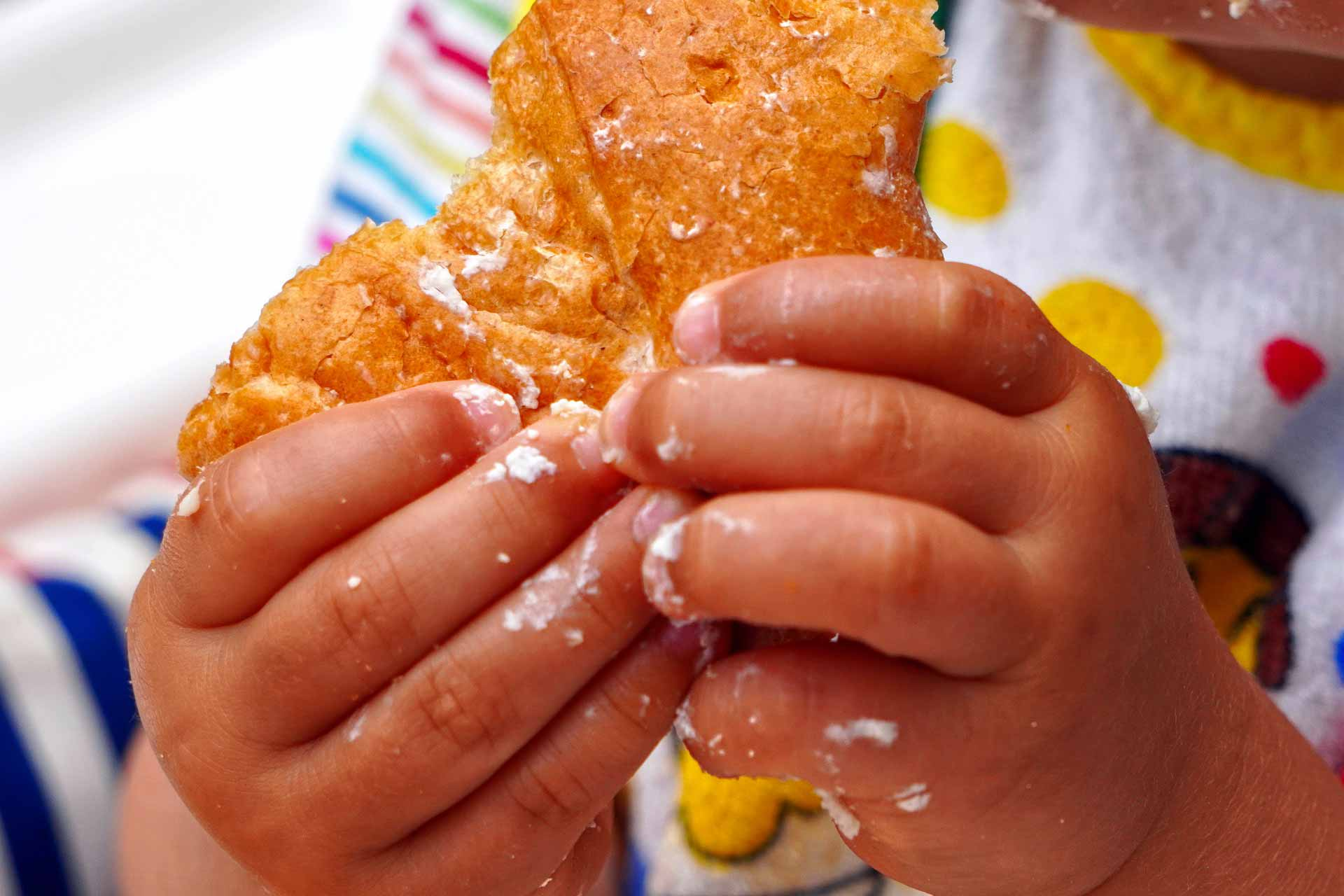 childrens hands eating