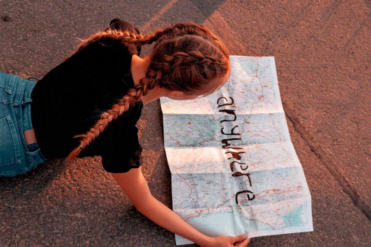 girl traveller travel tourism map