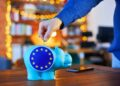 Savings, piggybank and EU flag