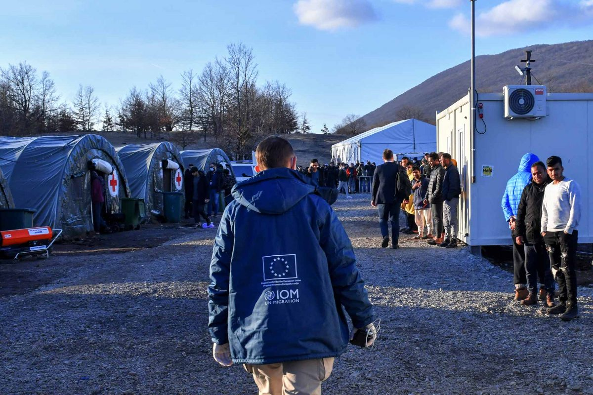 International Organization for Migration (IOM) walking in the Lipa camp for migrants